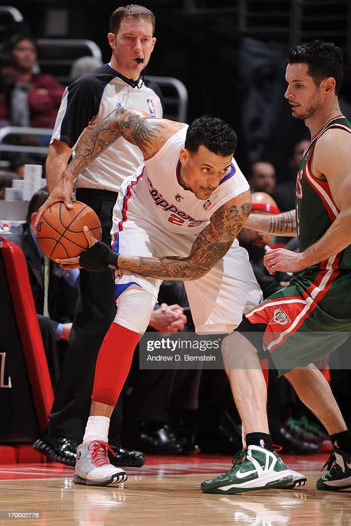 Matt Barnes #22 of the Los Angeles Clippers controls the ball against J.J. Redick #5 of the Milwaukee Bucks at Staples Center on March 6, 2013 in Los Angeles, California.