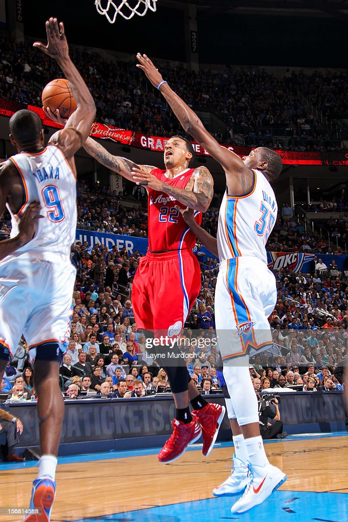 Matt Barnes #22 of the Los Angeles Clippers drives to the basket against Serge Ibaka #9 and Kevin Durant #35 of the Oklahoma City Thunder on November 21, 2012 at the Chesapeake Energy Arena in Oklahoma City, Oklahoma.