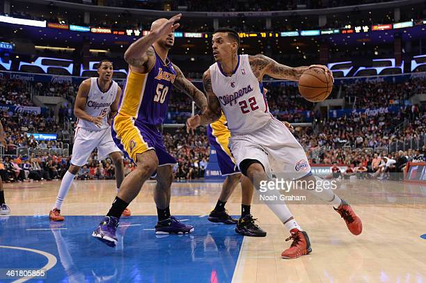 d974f0786 Matt Barnes of the Los Angeles Clippers drives to the basket against Robert  Sacre of the