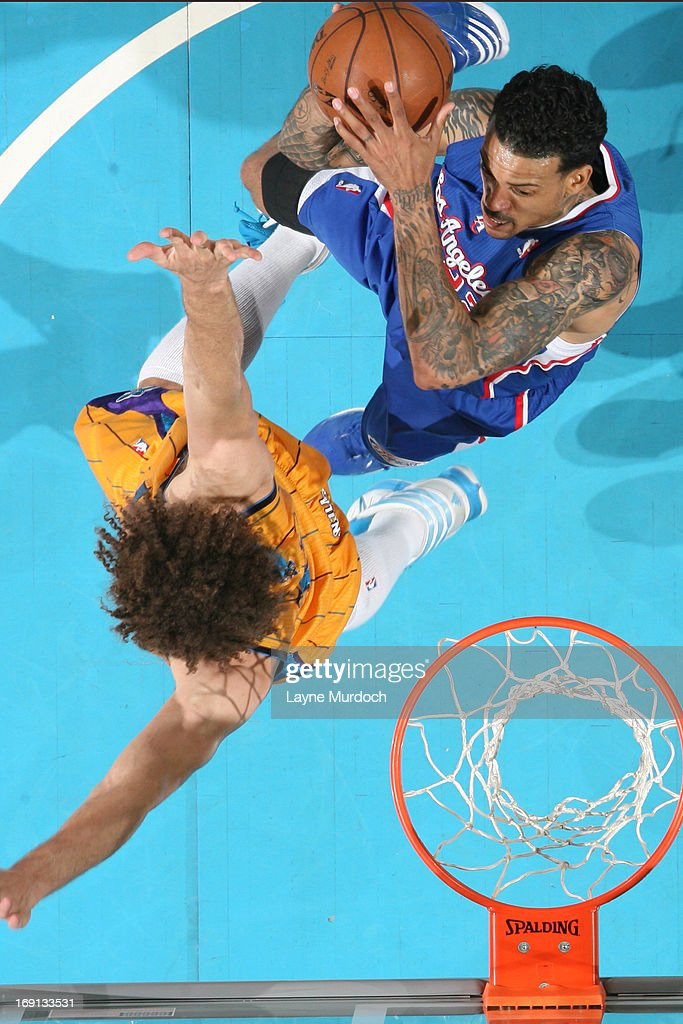 Matt Barnes #22 of the Los Angeles Clippers goes to the basket against Robin Lopez #15 of the New Orleans Hornets on April 12, 2013 at the New Orleans Arena in New Orleans, Louisiana.