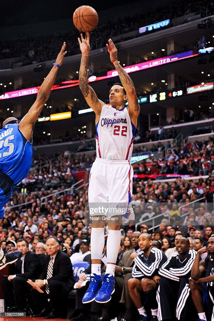Matt Barnes #22 of the Los Angeles Clippers shoots a three-pointer against Vince Carter #25 of the Dallas Mavericks at Staples Center on January 9, 2013 in Los Angeles, California.