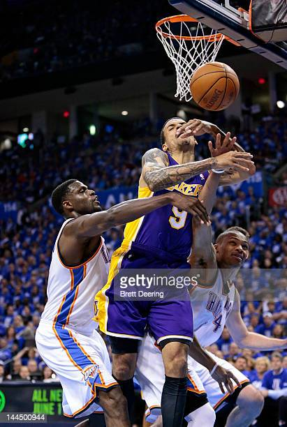 Matt Barnes of the Los Angeles Lakers Nazr Mohammed and Russell Westbrook of the Oklahoma City Thunder go for a loose ball in Game One of the Western...