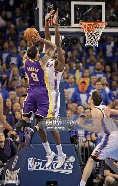 Matt Barnes of the Los Angeles Lakers shoots under pressure from Nazr Mohammed of the Oklahoma City Thunder in Game One of the Western Conference...