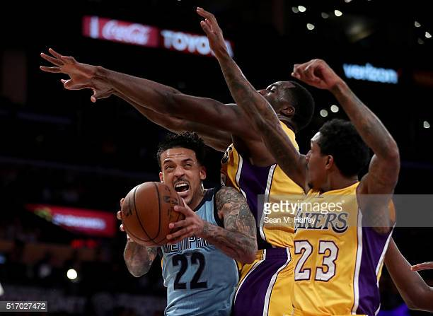 Matt Barnes of the Memphis Grizzlies drives to the basket against Louis Williams and Brandon Bass of the Los Angeles Lakers during the second half of...