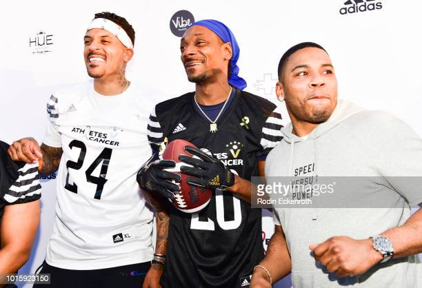 Matt Barnes Snoop Dogg and Nelly arrive at the 5th Annual Athletes vs Cancer Celebrity Flag Football Game at Fairfax High School on August 12 2018 in...
