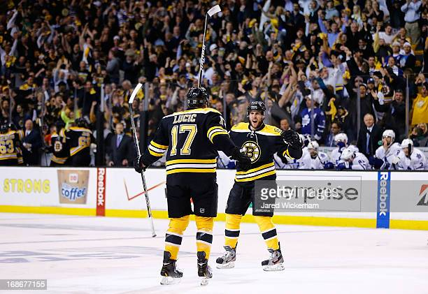 Matt Bartkowski celebrates with teammate Milan Lucic of the Boston Bruins after scoring a goal in the first period against the Toronto Maple Leafs in...