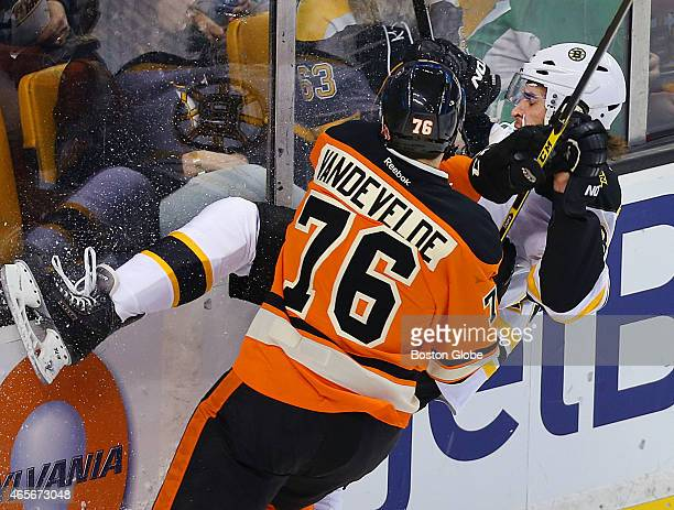 Matt Bartkowski gets a hard check into the boards in the first period by Flyers Chris VandeVelde