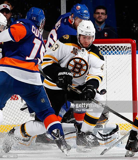 Matt Bartkowski of the Boston Bruins blocks a shot in an NHL hockey game against the New York Islanders at Nassau Veterans Memorial Coliseum on...