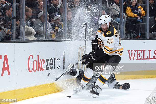 Matt Bartkowski of the Boston Bruins handles the puck during a game against the Los Angeles Kings at STAPLES Center on December 02 2014 in Los...