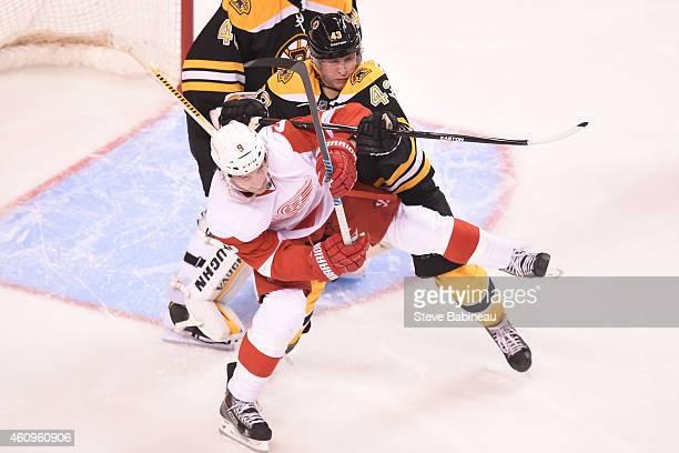 Matt Bartkowski of the Boston Bruins shoves Justin Abdelkader of the Detroit Red Wings at the TD Garden on December 29, 2014 in Boston, Massachusetts.