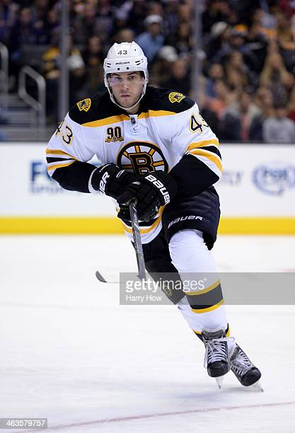 Matt Bartkowski of the Boston Bruins skates after the puck against the Los Angeles Kings at Staples Center on January 9 2014 in Los Angeles California
