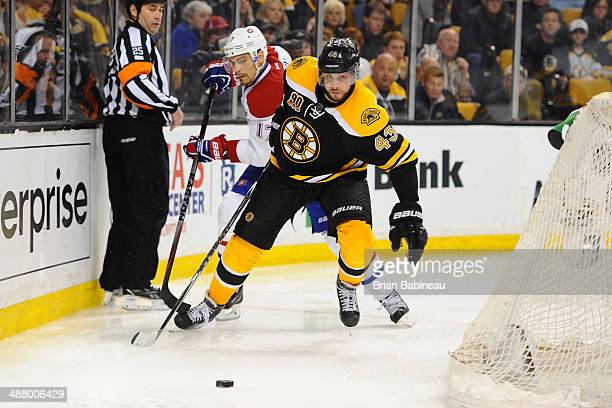 Matt Bartkowski of the Boston Bruins skates against Rene Bourque of the Montreal Canadiens in Game One of the Second Round of the 2014 Stanley Cup...
