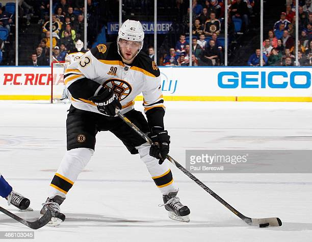 Matt Bartkowski of the Boston Bruins skates in an NHL hockey game against the New York Islanders at Nassau Veterans Memorial Coliseum on January 27...