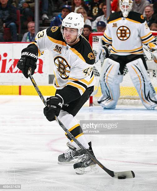 Matt Bartkowski of the Boston Bruins skates up ice with the puck during their NHL game against the Vancouver Canucks at Rogers Arena December 14,...