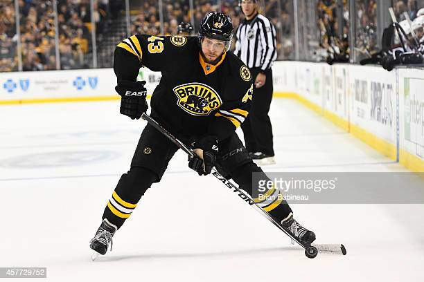 Matt Bartkowski of the Boston Bruins skates with the puck against the Colorado Avalanche at the TD Garden on October 13, 2014 in Boston,...
