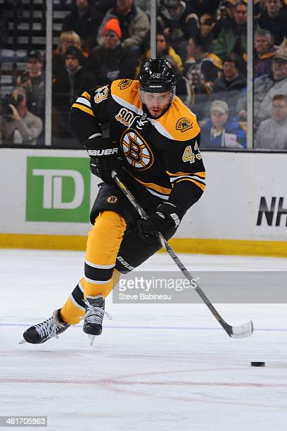 Matt Bartkowski of the Boston Bruins skates with the puck against the Nashville Predators at the TD Garden on January 2 2014 in Boston Massachusetts