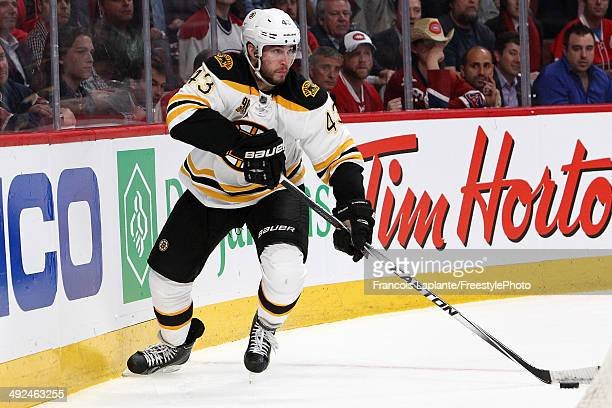 Matt Bartkowski of the Boston Bruins skates with the puck against the Montreal Canadiens in Game Six of the Second Round of the 2014 NHL Stanley Cup...