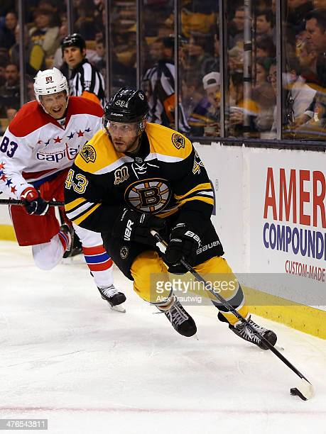 Matt Bartkowski of the Boston Bruins skates with the puck behind the net against the Washington Capitals during a game at the TD Garden on March 1...