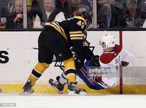 Matt Bartkowski of the Boston Bruins takes the first period penalty for holding Lars Eller of the Montreal Canadiens during Game Five of the Second...