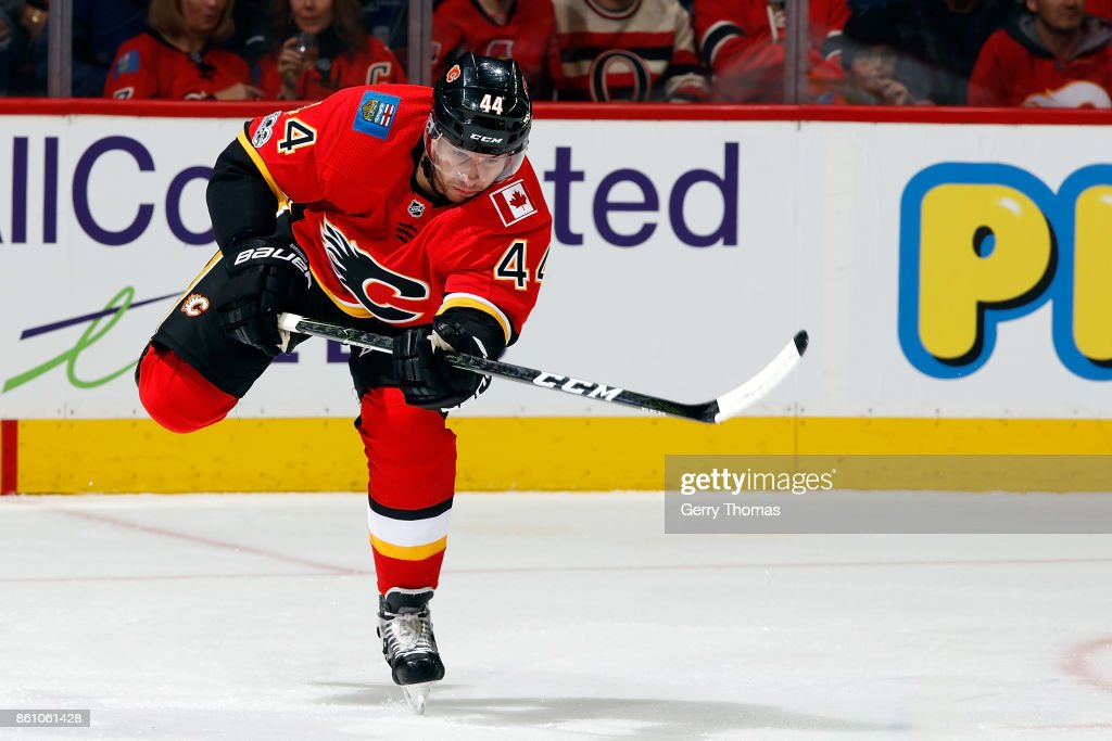 Matt Bartkowski #44 of the Calgary Flames shoots the puck against the Ottawa Senators during an NHL game on October 13, 2017 at the Scotiabank Saddledome in Calgary, Alberta, Canada.