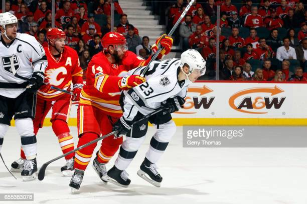 Matt Bartkowski of the Calgary Flames skates against Dustin Brown of the Los Angeles Kings during an NHL game on March 19, 2017 at the Scotiabank...