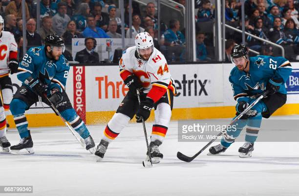 Matt Bartkowski of the Calgary Flames skates against Joonas Donskoi of the San Jose Sharks at SAP Center on April 8 2017 in San Jose California