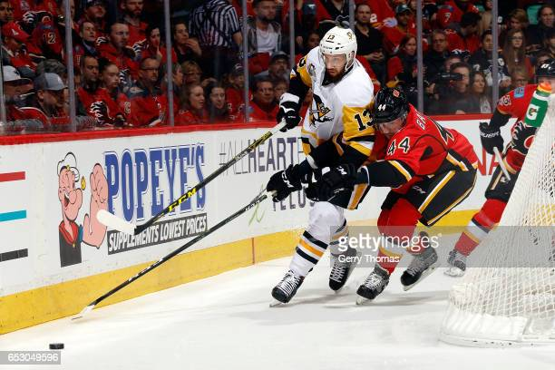 Matt Bartkowski of the Calgary Flames skates against Nick Bonino of the Pittsburgh Penguins during an NHL game on March 13, 2017 at the Scotiabank...