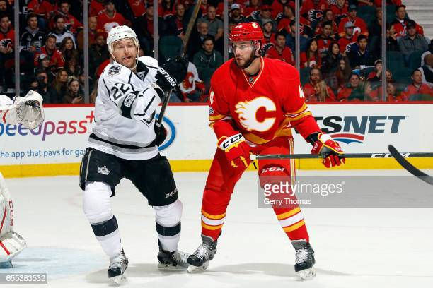 Matt Bartkowski of the Calgary Flames skates against Trevor Lewis of the Los Angeles Kings during an NHL game on March 19, 2017 at the Scotiabank...