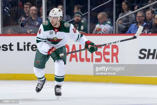 Matt Bartkowski of the Minnesota Wild follows the play down the ice during first period action against the Winnipeg Jets at the Bell MTS Place on...