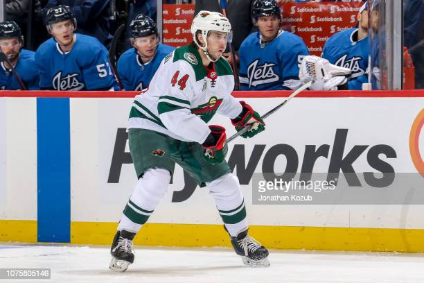 Matt Bartkowski of the Minnesota Wild keeps an eye on the play during first period action against the Winnipeg Jets at the Bell MTS Place on December...