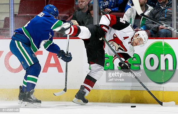 Matt Bartkowski of the Vancouver Canucks checks Antoine Vermette of the Arizona Coyotes during their NHL game at Rogers Arena March 9, 2016 in...