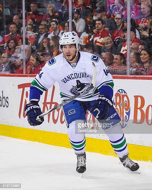 Matt Bartkowski of the Vancouver Canucks in action against the Calgary Flames during an NHL game at Scotiabank Saddledome on April 7 2016 in Calgary...
