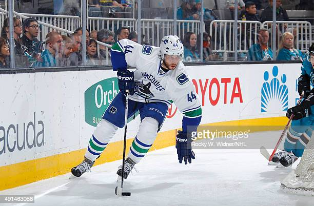 Matt Bartkowski of the Vancouver Canucks skates with control of the puck against the San Jose Sharks at SAP Center on September 29 2015 in San Jose...