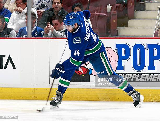 Matt Bartkowski of the Vancouver Canucks takes a shot during their NHL game against the Colorado Avalanche at Rogers Arena March 16, 2016 in...