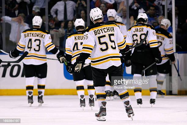 Matt Bartkowski Torey Krug Johnny Boychuk and Jaromir Jagr of the Boston Bruins skate off of the ice after they lost 43 in overtime against the New...