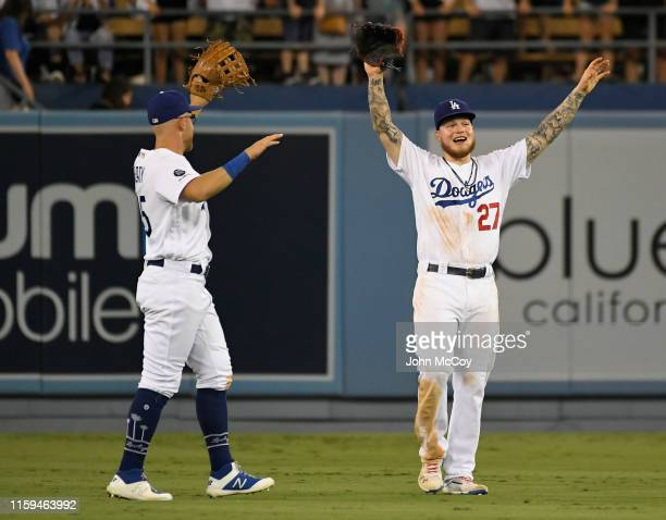 Matt Beaty of the Los Angeles Dodgers walks toward Alex Verdugo after the final out against the San Diego Padres at Dodger Stadium on August 3 2019...