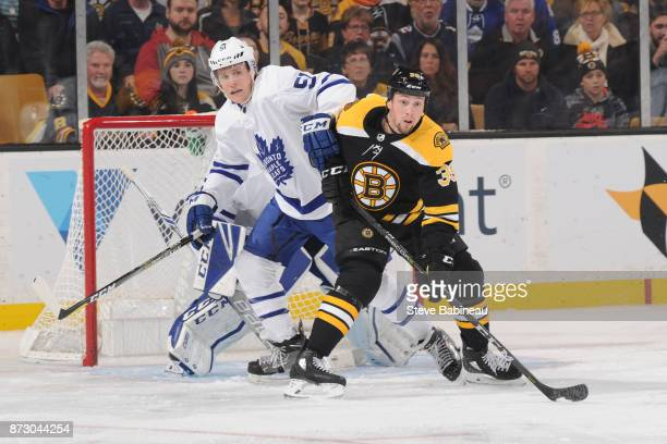 Matt Beleksey of the Boston Bruins against Jake Gardiner of the Toronto Maple Leafs at the TD Garden on November 11 2017 in Boston Massachusetts