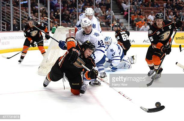 Matt Beleskey of the Anaheim Ducks attempts a pass to Ryan Getzlaf in front of Tyler Bozak of the Toronto Maple Leafs during a 3-1 Maple Leaf win at...