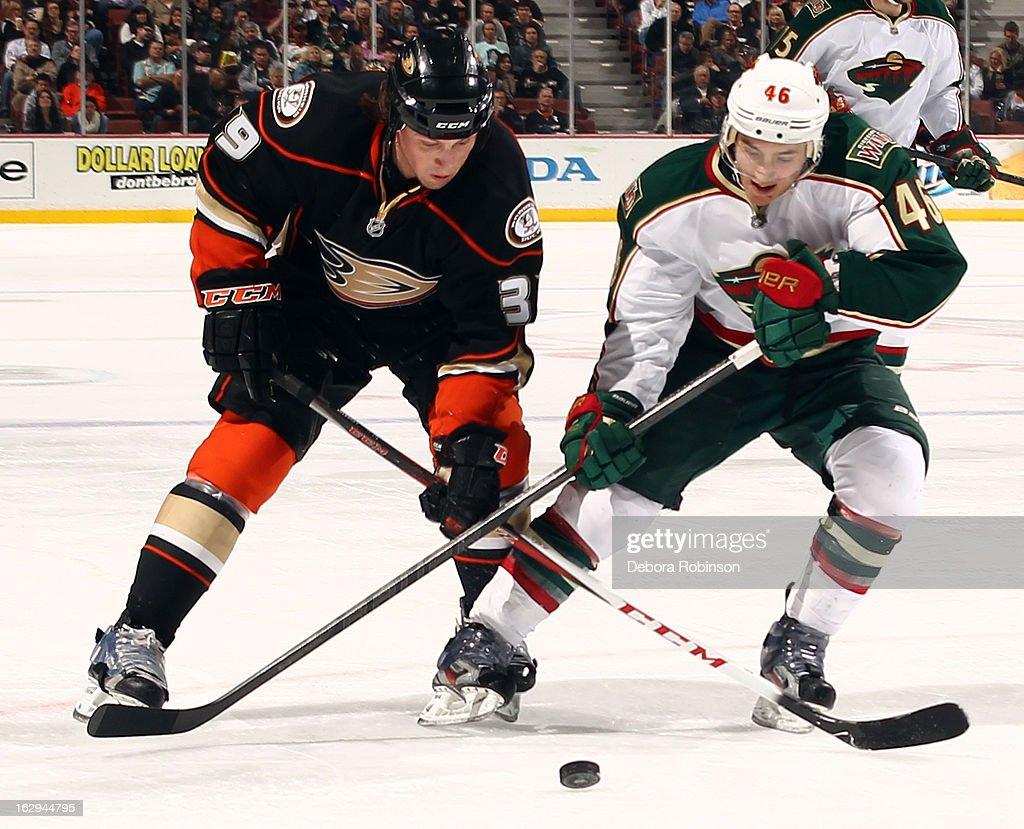 Matt Beleskey #39 of the Anaheim Ducks battles for the puck against Jared Spurgeon #46 of the Minnesota Wild on March 1, 2013 at Honda Center in Anaheim, California.