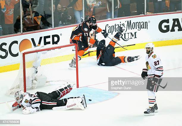 Matt Beleskey of the Anaheim Ducks celebrates scoring the game winning goal with teammate Ryan Kesler as goaltender Corey Crawford of the Chicago...