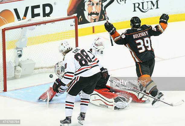Matt Beleskey of the Anaheim Ducks celebrates scoring the game winning goal as he trips over goaltender Corey Crawford of the Chicago Blackhawks in...