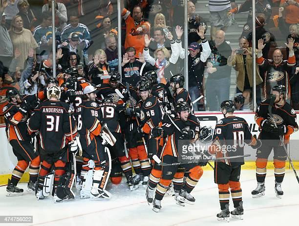 Matt Beleskey of the Anaheim Ducks celebrates with Corey Perry and teammates after he scored the game winning overime goal to defeat the Chicago...
