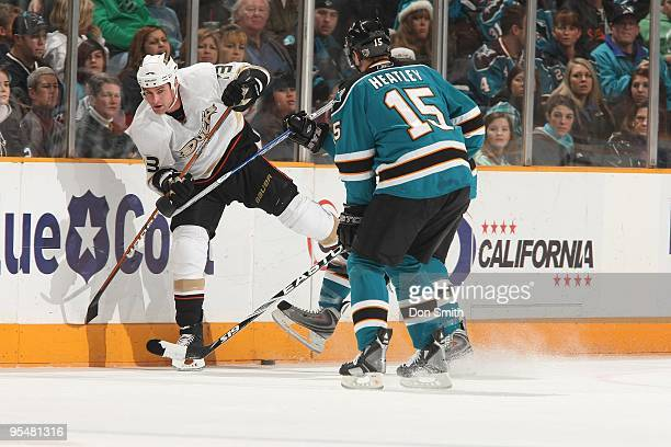 Matt Beleskey of the Anaheim Ducks tries to avoid a hit during an NHL game against the San Jose Sharks on December 26, 2009 at HP Pavilion at San...
