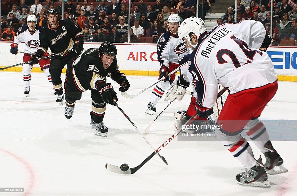Matt Beleskey #39 of the Anaheim Ducks tries to strip the puck from Derek MacKenzie #24 of the Columbus Blue Jackets on February 18, 2013 at Honda Center in Anaheim, California.