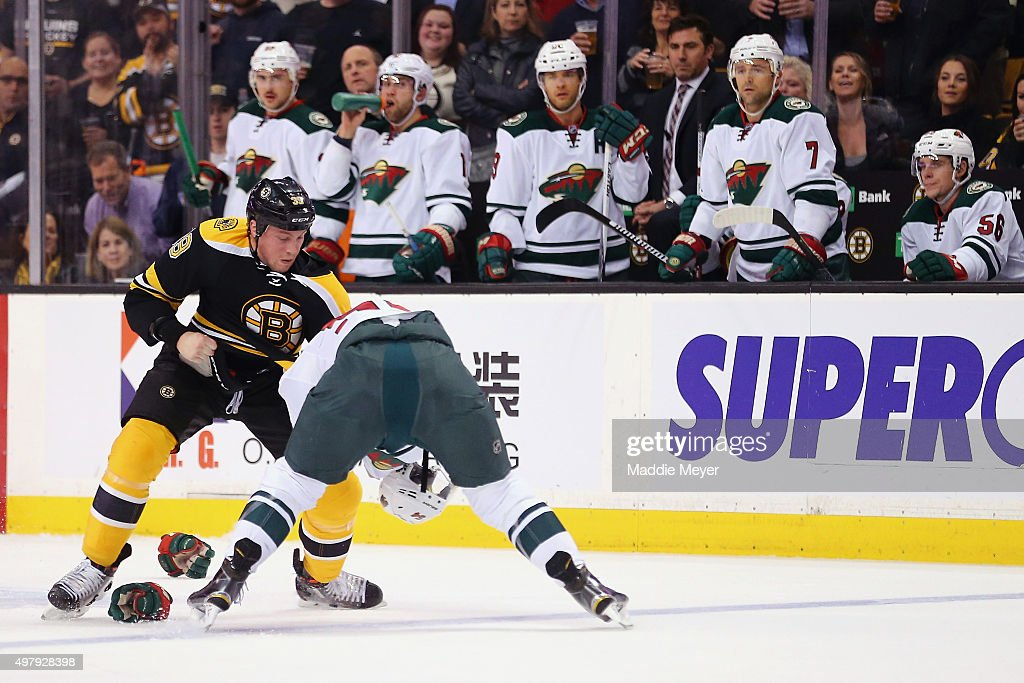 Matt Beleskey #39 of the Boston Bruins and Brett Bulmer #54 of the Minnesota Wild exchange punches during the first period at TD Garden on November 19, 2015 in Boston, Massachusetts.