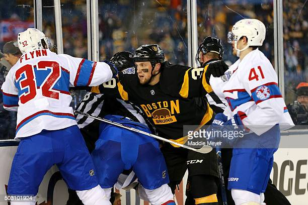 Matt Beleskey of the Boston Bruins holds back Brian Flynn and Paul Byron of the Montreal Canadiens late in the third period during the 2016...