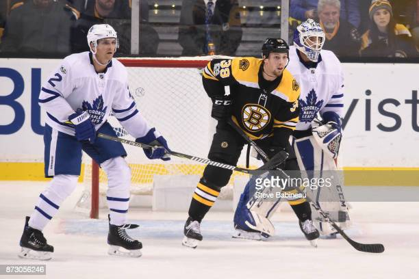 Matt Beleskey of the Boston Bruins watches the play against Ron Hainsey and Curtis McElhinney of the Toronto Maple Leafs at the TD Garden on November...