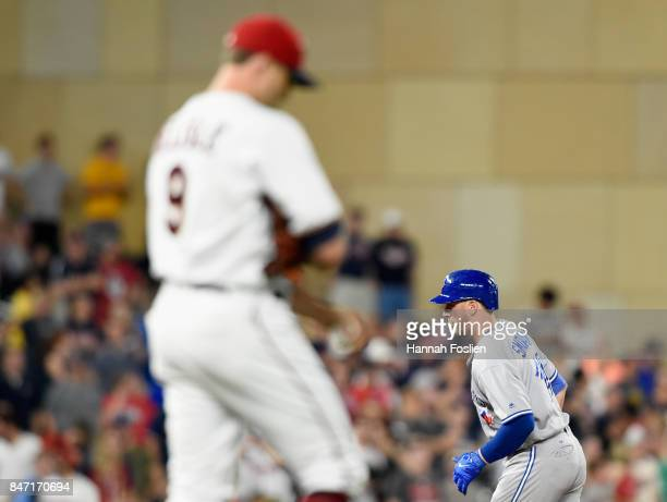 Matt Belisle of the Minnesota Twins looks on as Justin Smoak of the Toronto Blue Jays rounds the bases after hitting a solo home run during the ninth...