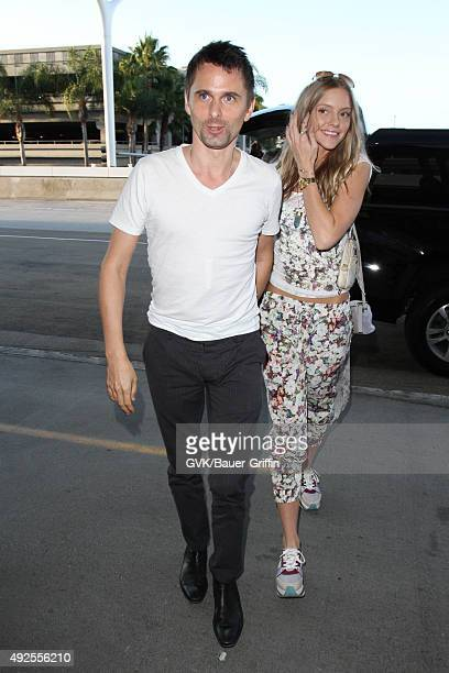 Matt Bellamy and Elle Evans are seen at LAX on October 13 2015 in Los Angeles California
