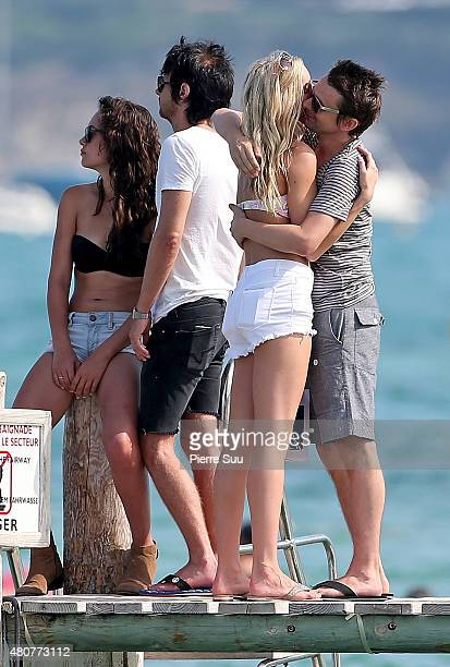 Matt Bellamy and Elle Evans embrace at club 55 on July 15 2015 in SaintTropez France